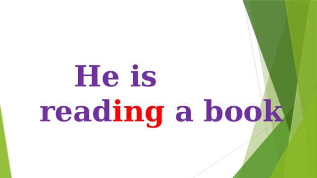 He is read ing a book
