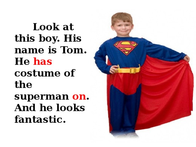 Look at this boy. His name is Tom. He has costume of the superman on . And he looks fantastic.