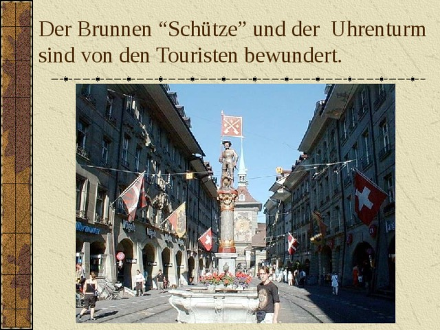 """Der Brunnen """"Schütze"""" und der  Uhrenturm  sind von den Touristen bewundert."""
