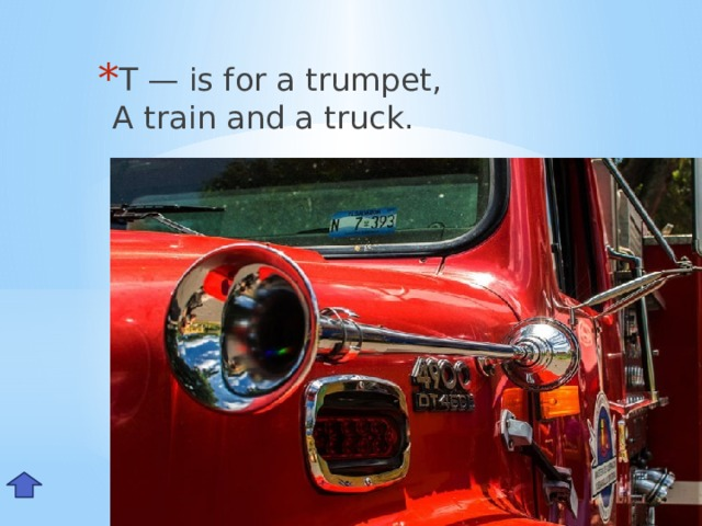 T — is for a trumpet,  A train and a truck. Tt